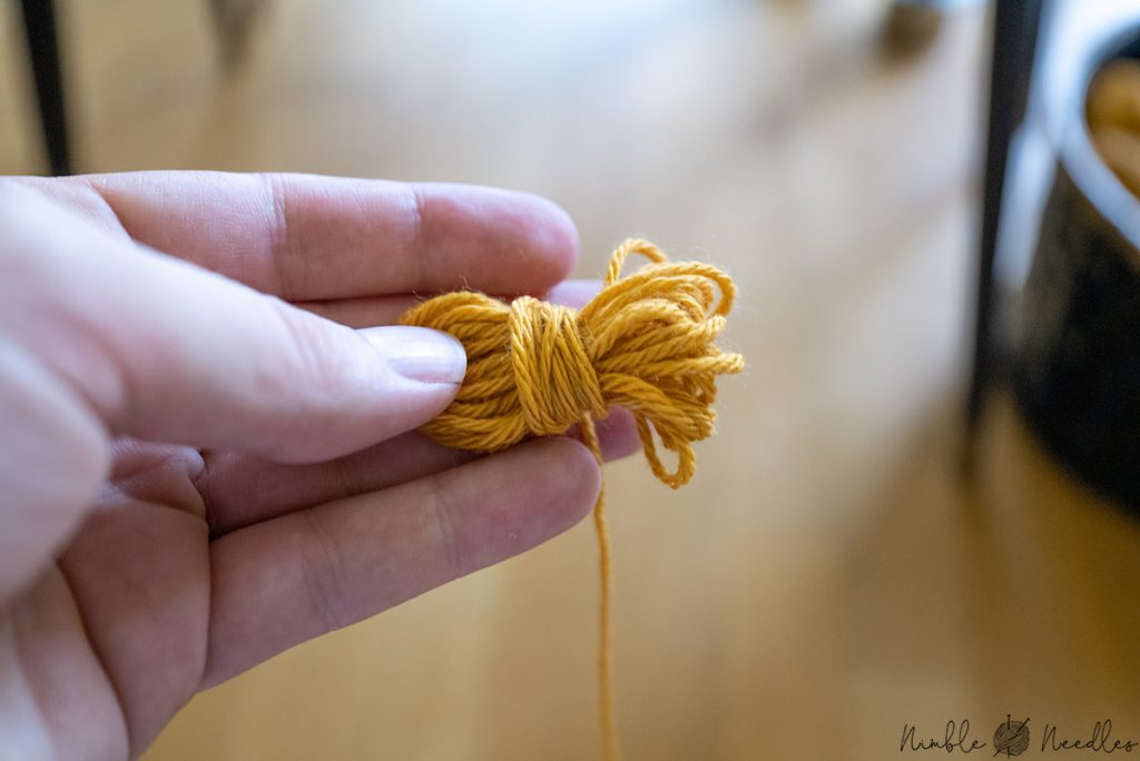 making a little parcel out of the yarn by winding it the other way around