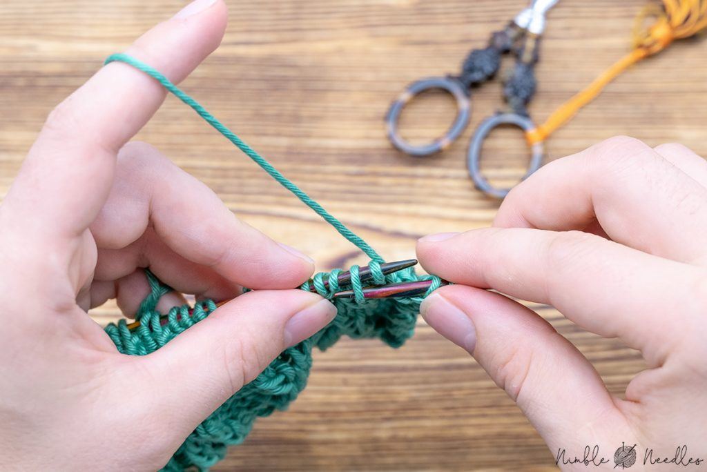 inserting the needle into the second stitch form the front for a right traveling bavarian twisted stitch