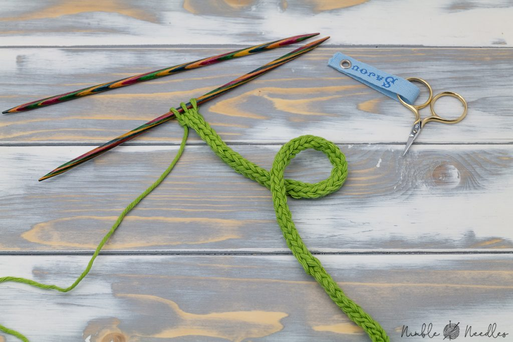 knitting an icord with green cotton yarn on double-pointed needles
