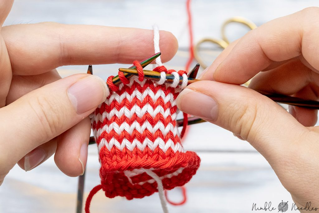 dropping the yarn and to slip three stitches to start your helix knitting