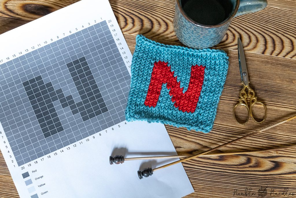 An intarsia knitting chart with a swatch next to it