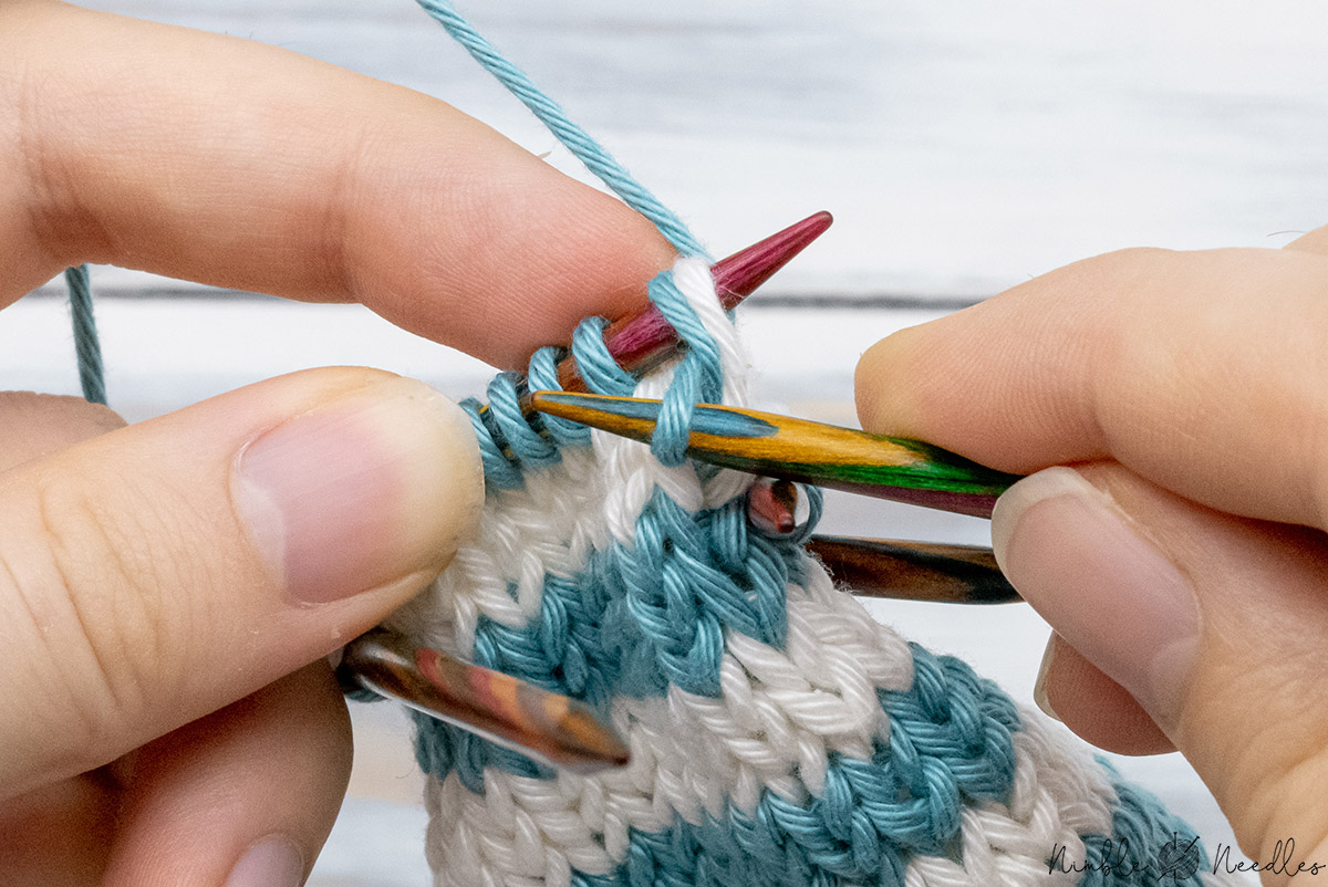 knitting the next stitch and the lifted stitch together