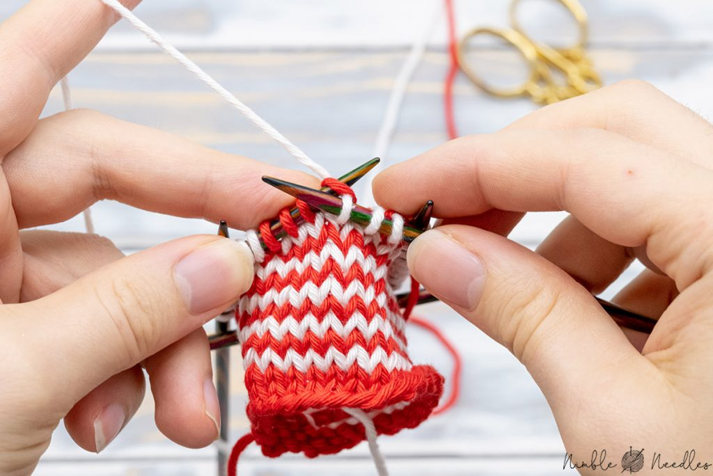 knitting until thee stitches before the beginning of the next color to start the helix