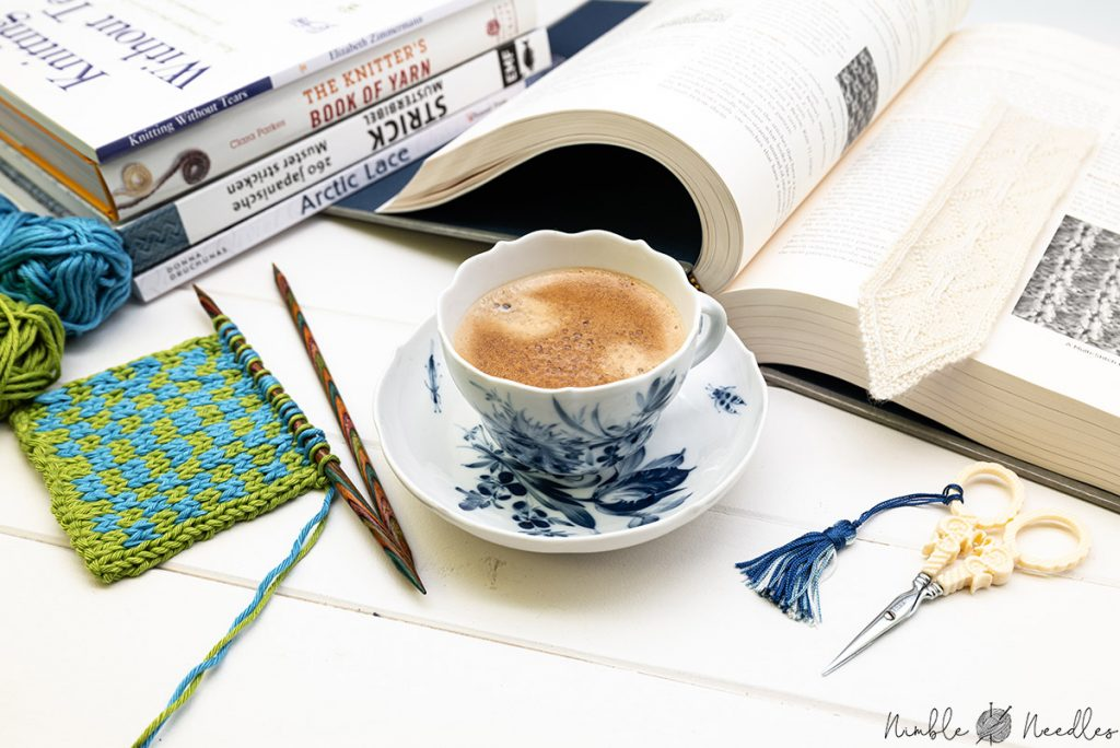 reading my favorite knitting books with a cup of coffee