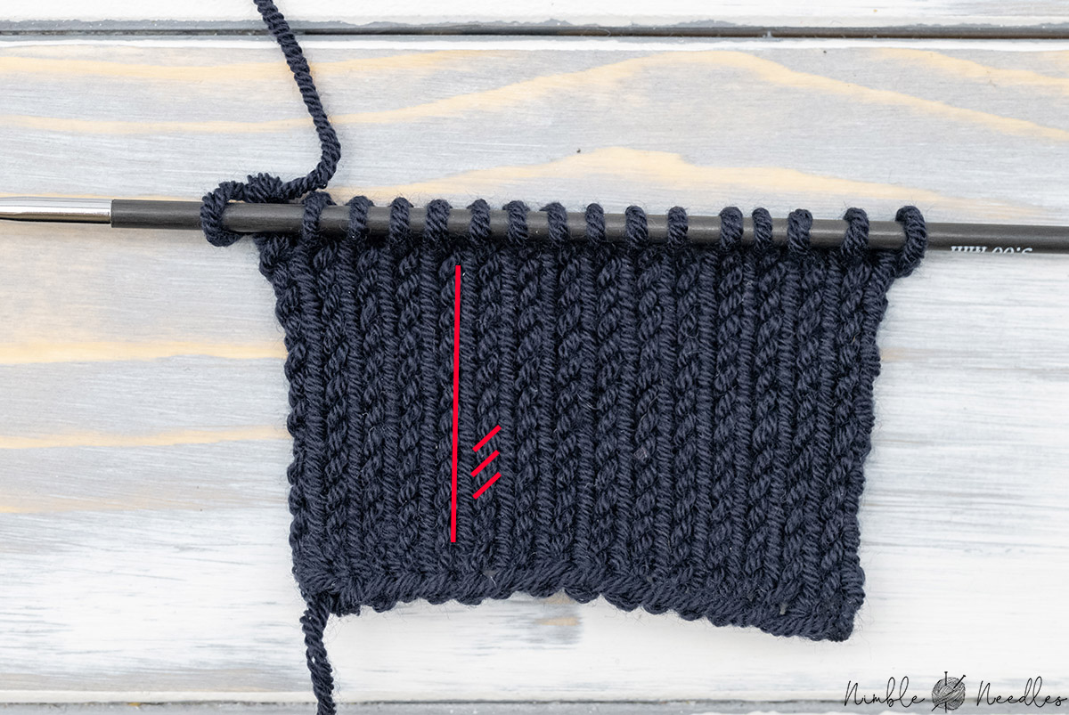 A swatch of stockinette stitch knit with a high ply yarn which makes the legs of the stitches twist into each other