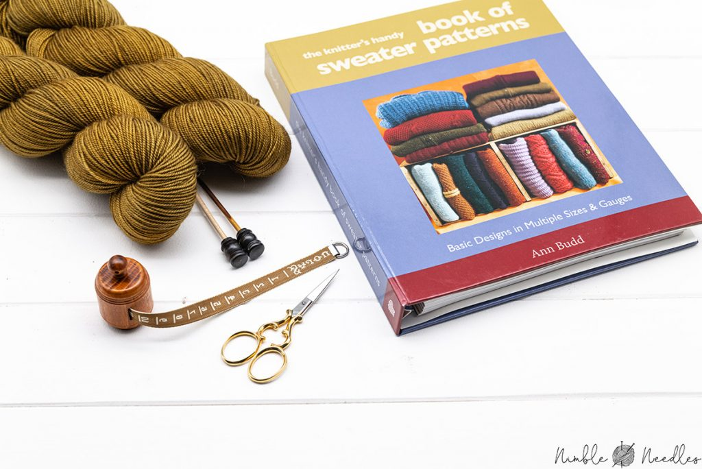 the knitter's handy sweater book of patterns by ann budd on a table