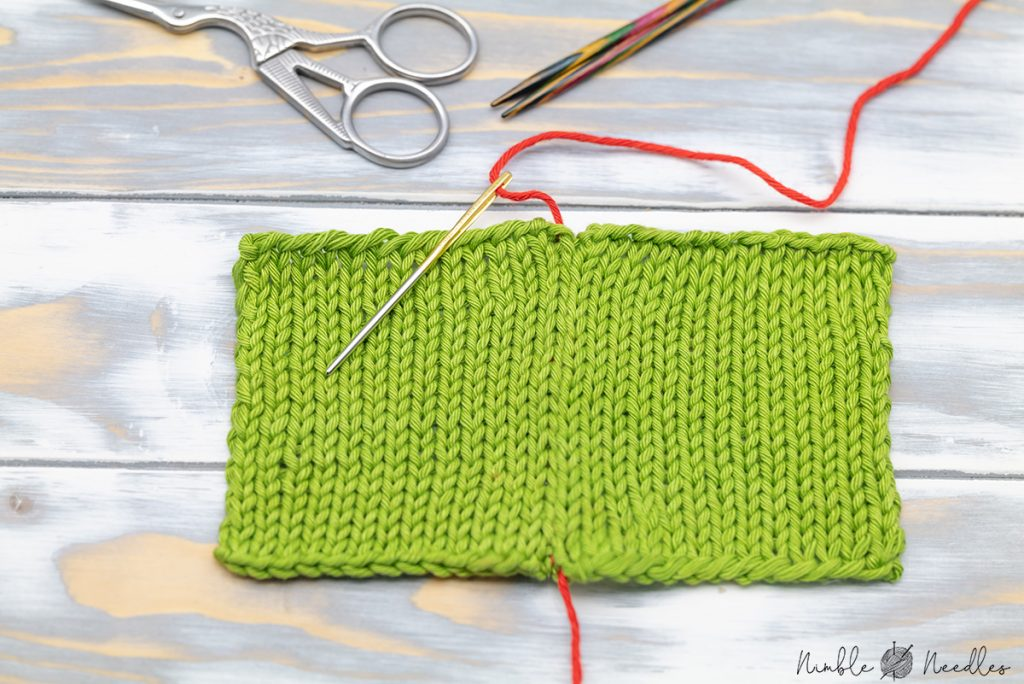 two knitted pieces joined with a tapestry needle using the mattress stitch