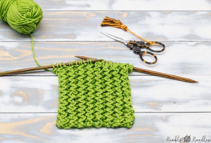 a swatch knitted in the ziggzag rib stitch pattern in green yarn