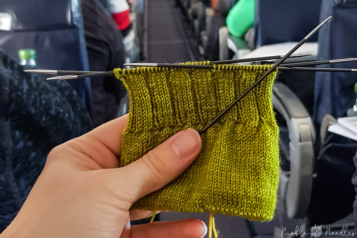 Knitting needles on a plane for a simple sock pattern