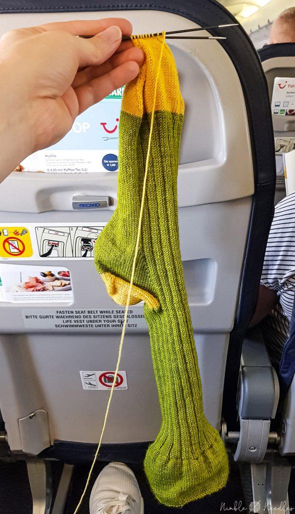 knitting socks on a plane