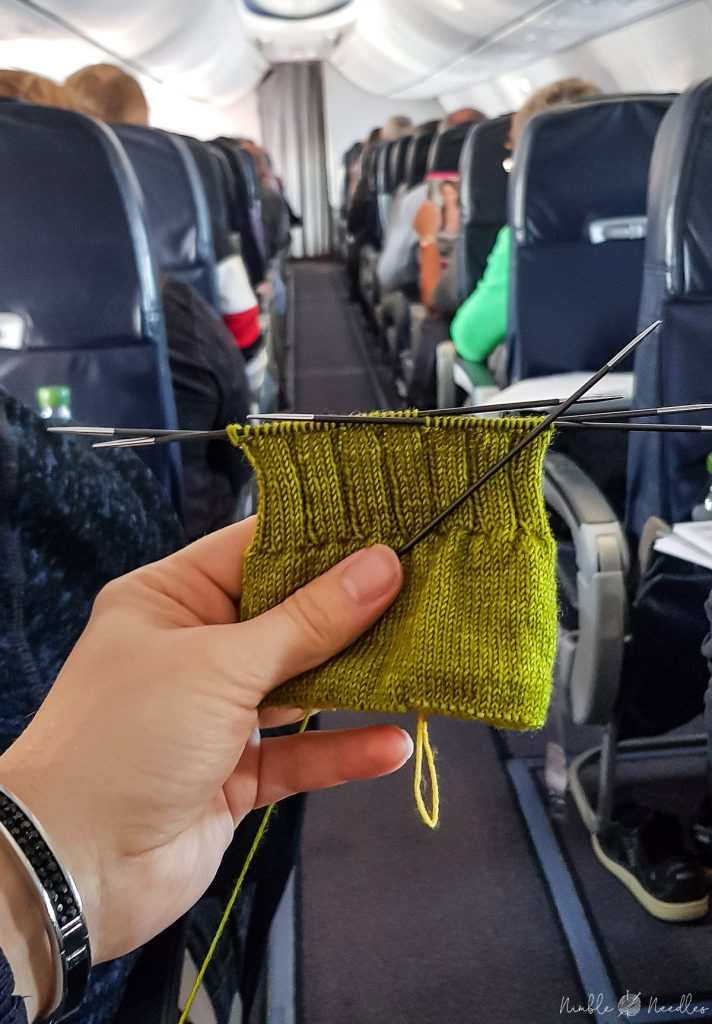 knitting socks with double-pointed knitting needles on a plan. you can bring them in your carry-on luggage