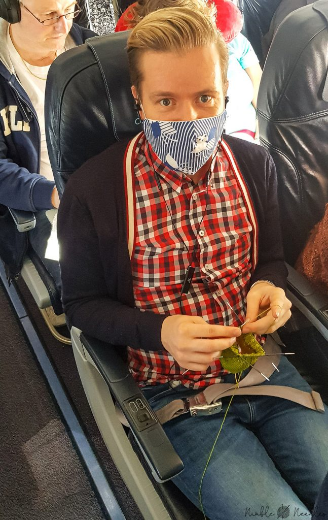 Me knitting on a plane in Europe.  simple ribbed sock in this case.