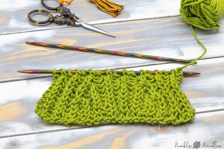 close-up of a swatch with left- and right-leaning brioche stitch decreases