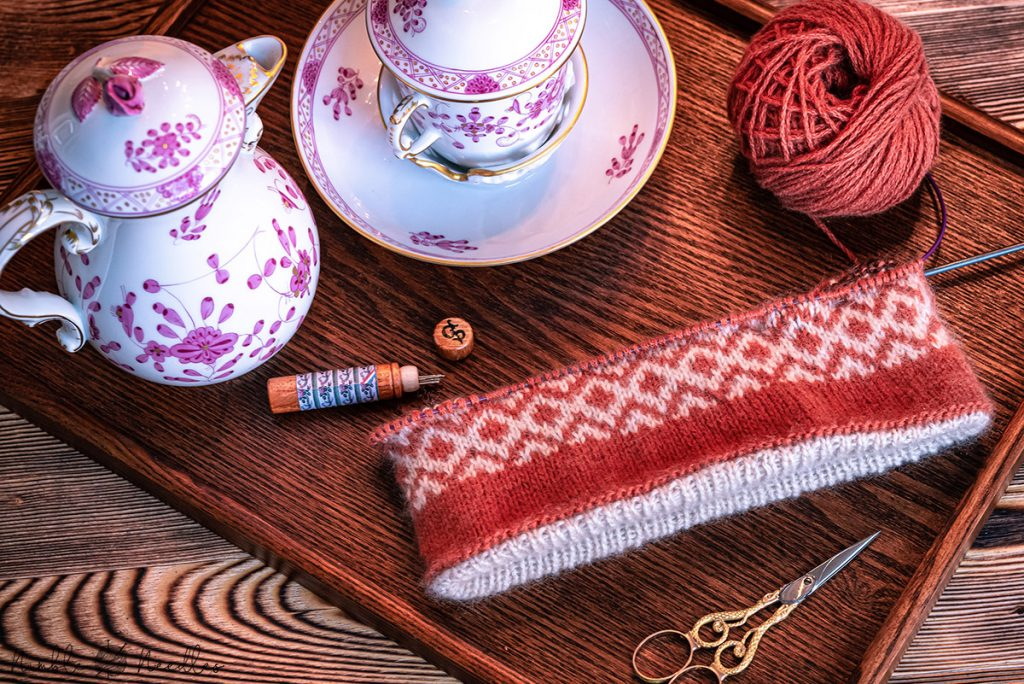 a work in progress of the knitted headband with the fair isle section almost finished