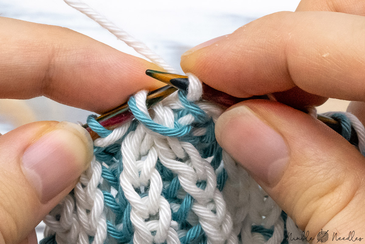 slipping one stitch from the right needle back to the left needle
