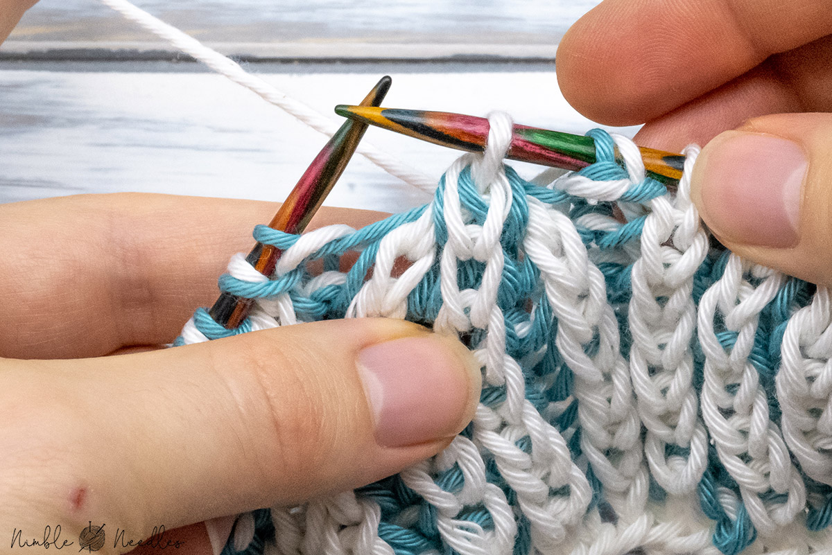 slipping the remaining stitch back to the left needle to finish the brioche stitch double decrease