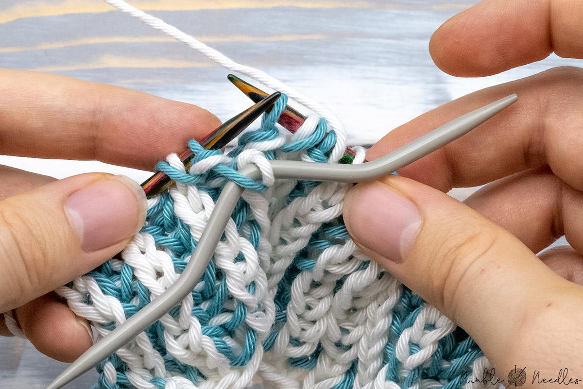 slipping a brioche knit stitch to a cable needle