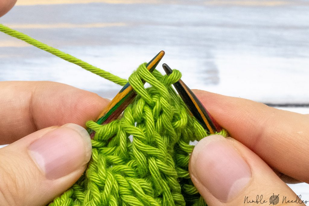 passing a double stitch over to finish the left-leaning decrease