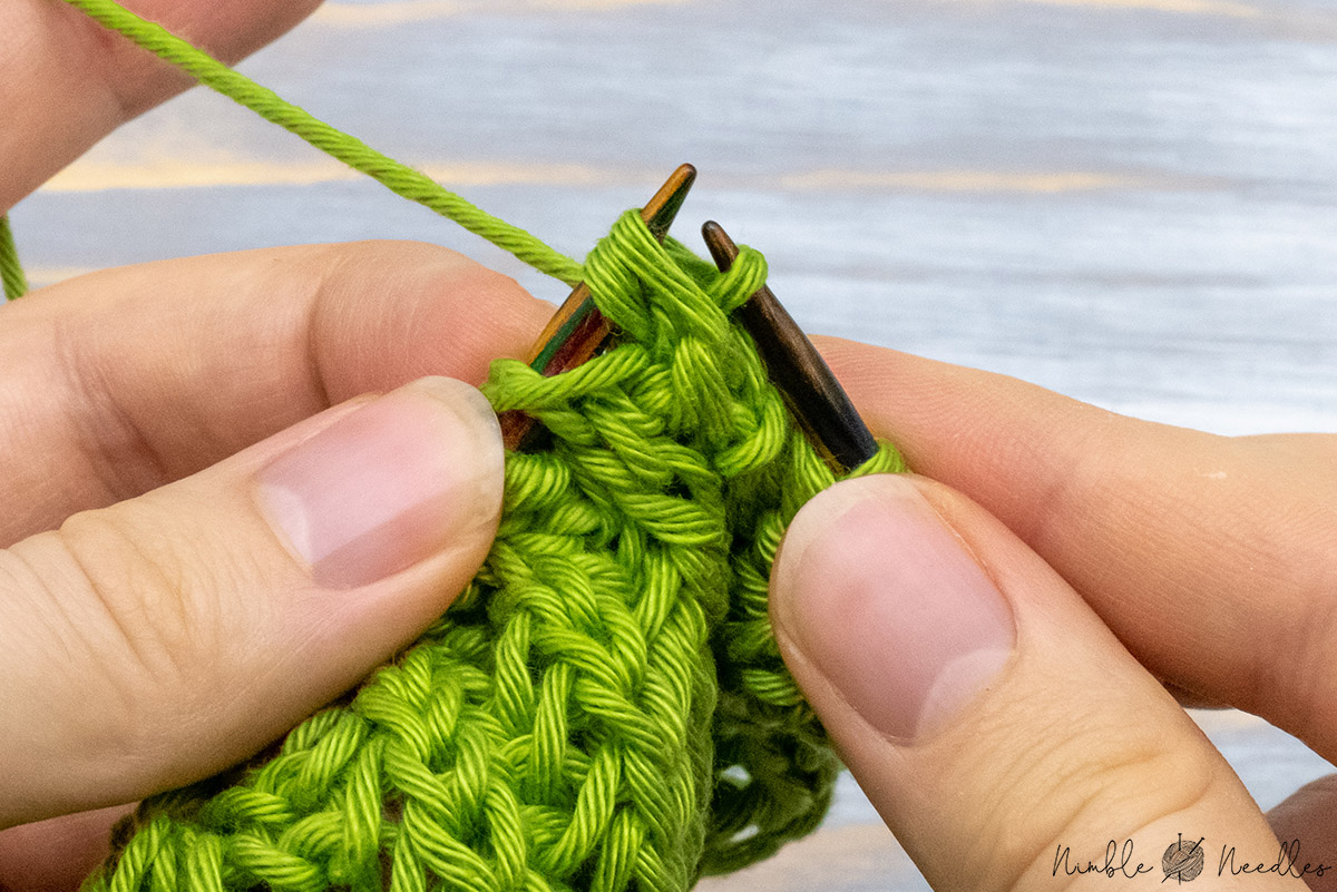 passing a double stitch over the one you just slipped