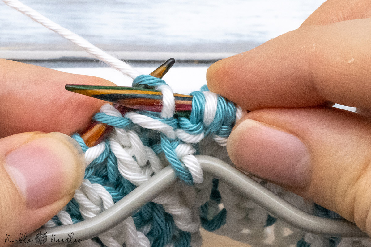 knitting one stitch for the brioche 4 stitch decrease