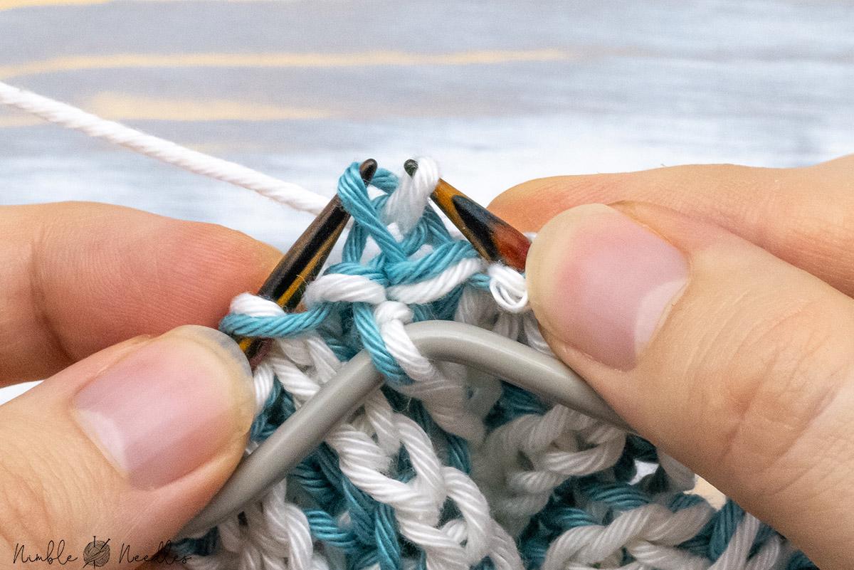 passing a stitch over to begin the brioche double decrease