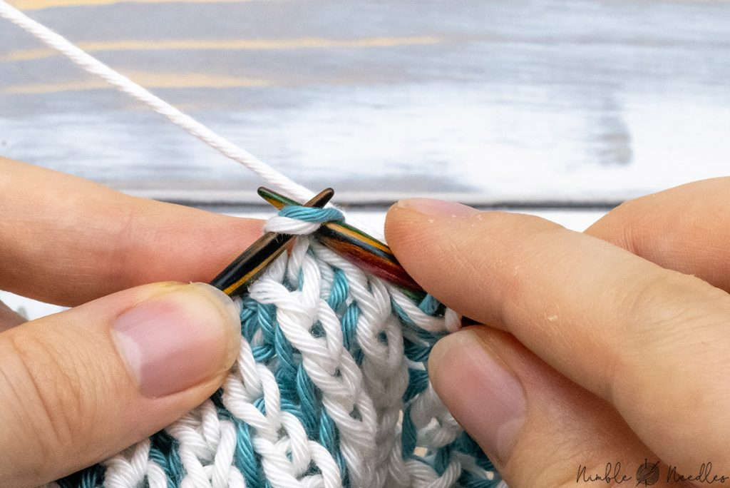 slipping two stitches knitwise to the right needle