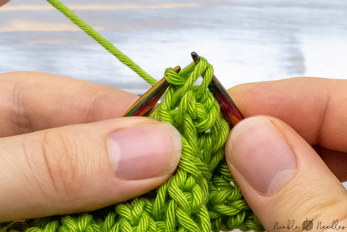 passing another double stitch over the first stitch