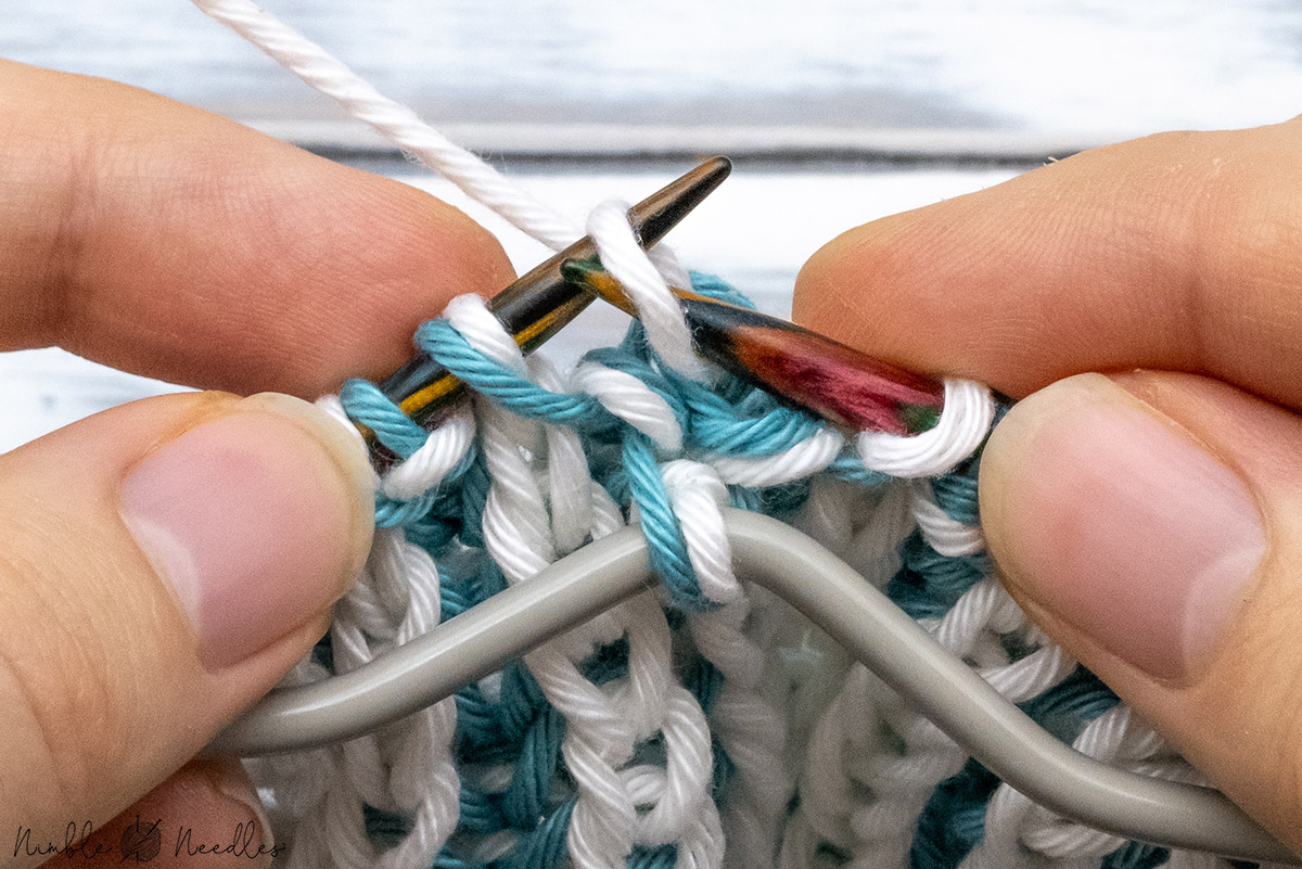 slipping the first stitch on the right needle back to the left needle