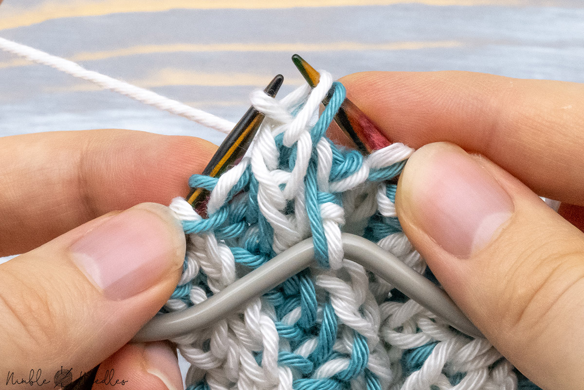 passing a double stitch over the first stitch