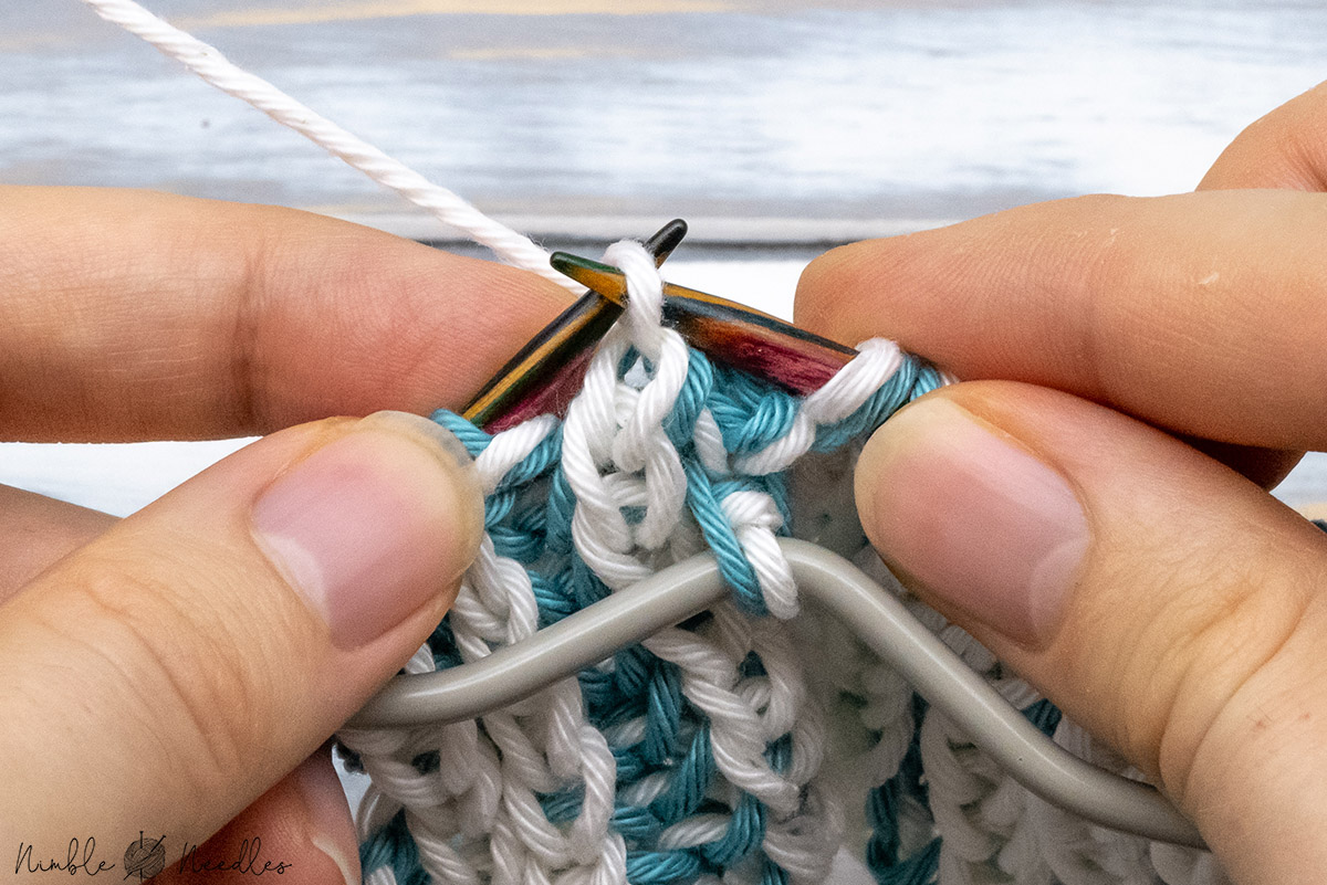 slipping the remaining stitch back to the right needle