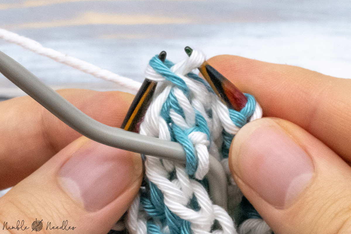 passing the last double stitch over the stitch you just slipped