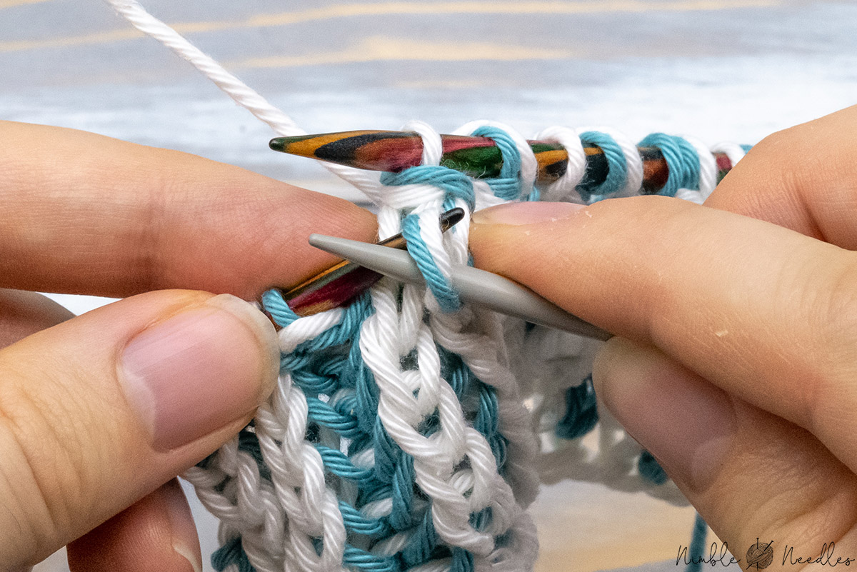 slipping the brioche knit stitch form the cable needle back to the left needle
