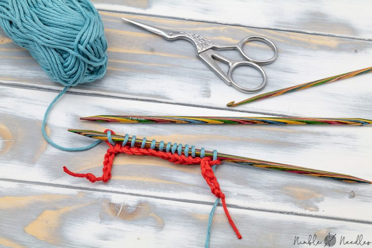 the provisional cast on with a crochet hook method after one round of knitting across it
