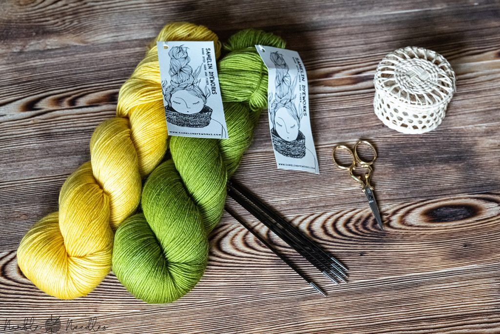hand-dyed yarn by samelin dyeworks in yellow and green for this sock pattern