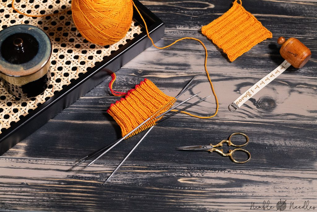 casting on the required number of stitches for a sock based on a swatch
