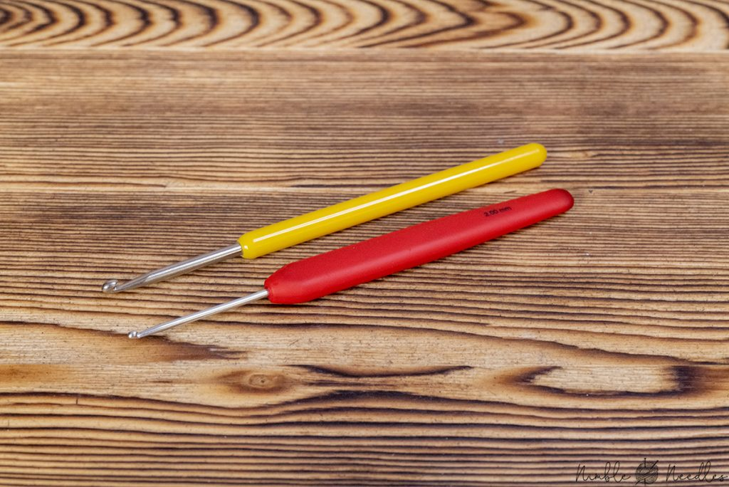 two different crochet hooks for picking up stitch and fixing mistakes in knitting