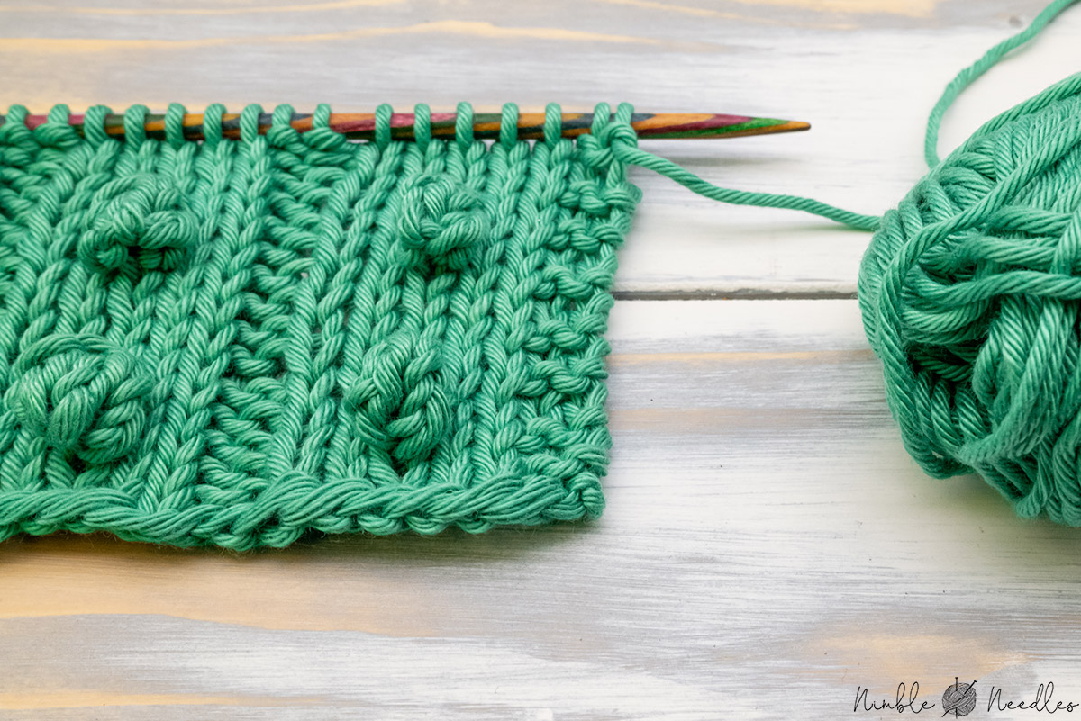 a swatch showing how changing the increases for the bobble stitch matters