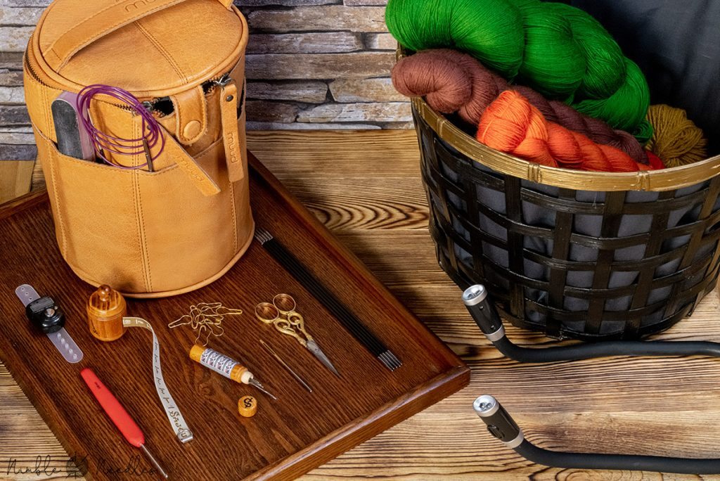 A knitting toolkit with all the items a knitter needs to finish a simple project