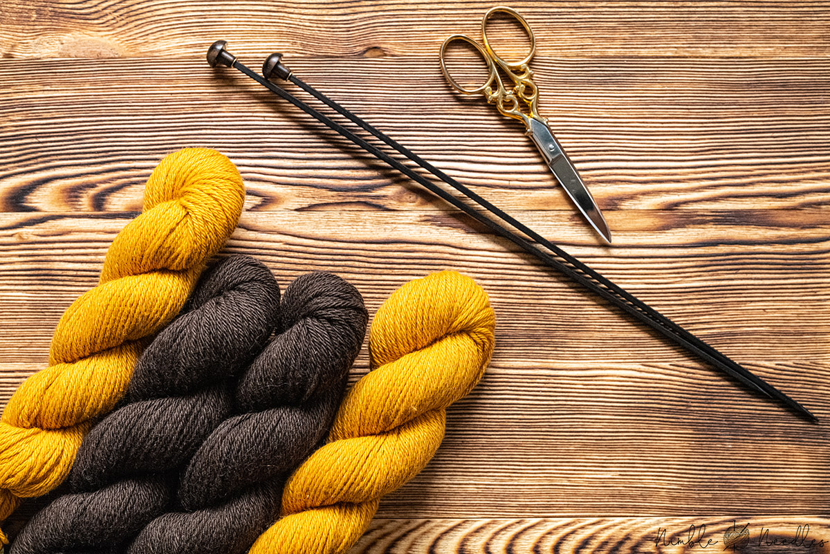 skeins of 100% yak wool in yellow and brown