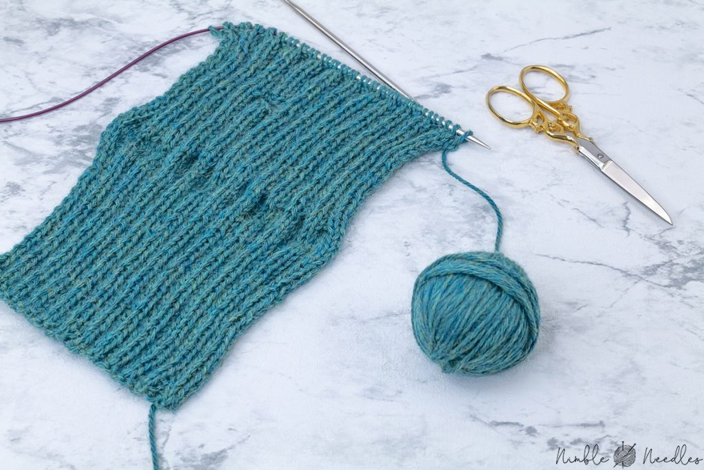 after having knitted the last row of this fingerless gloves knitting pattern