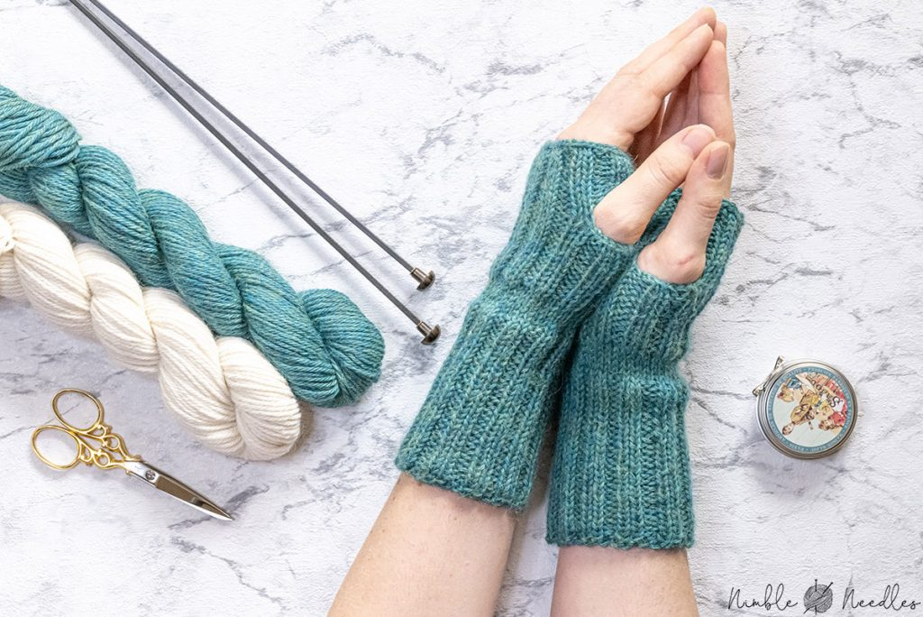 wearing the fingerless gloves so you can see the profile of the pattern