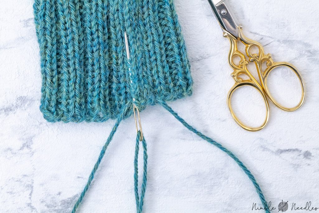weaving in the tails after you closed the seams of the fingerless gloves