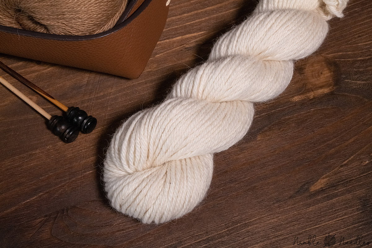 a hank of alpaca yarn on a wooden board