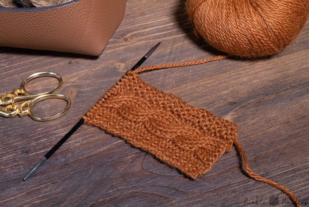 cable stitch swatch knitted with alpaca yarn in rich brown color