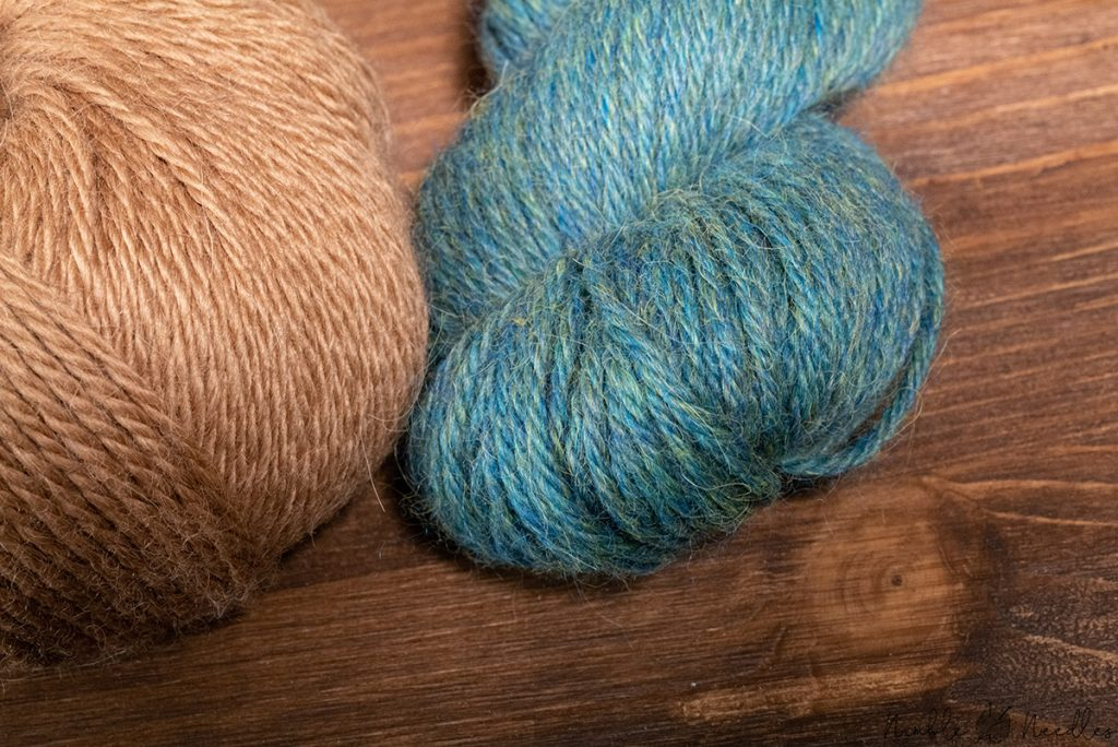 close-up of a alpaca yarn showing how the awn hair take color differently