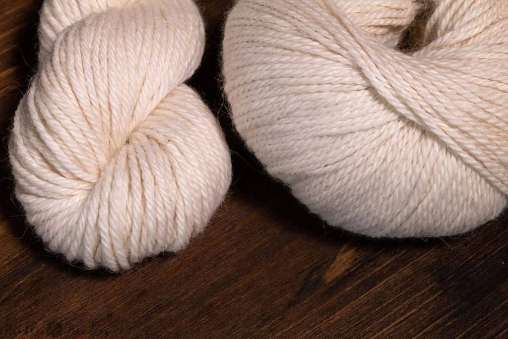 difference between baby alpaca and superfine alpaca yarn as shown with two different skeins
