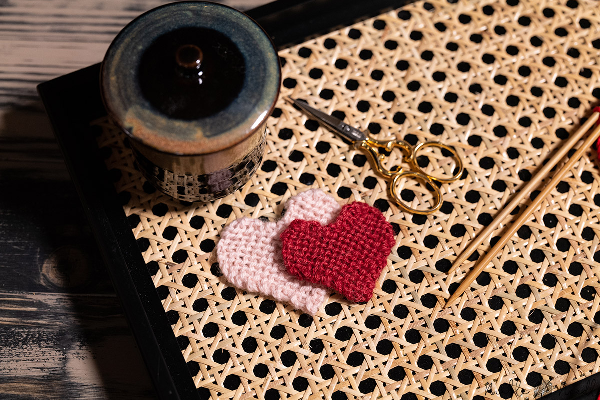 two knitted hearts using a slighly fuzzy wool to hide mistakes