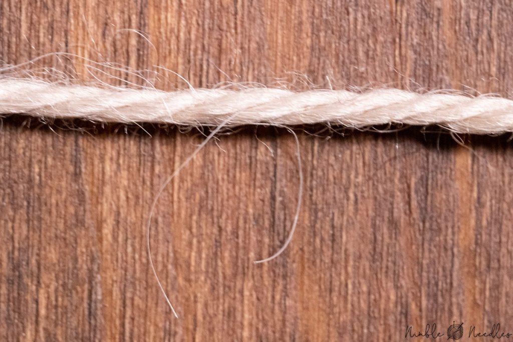 macro shot of a single alpaca yarn thread