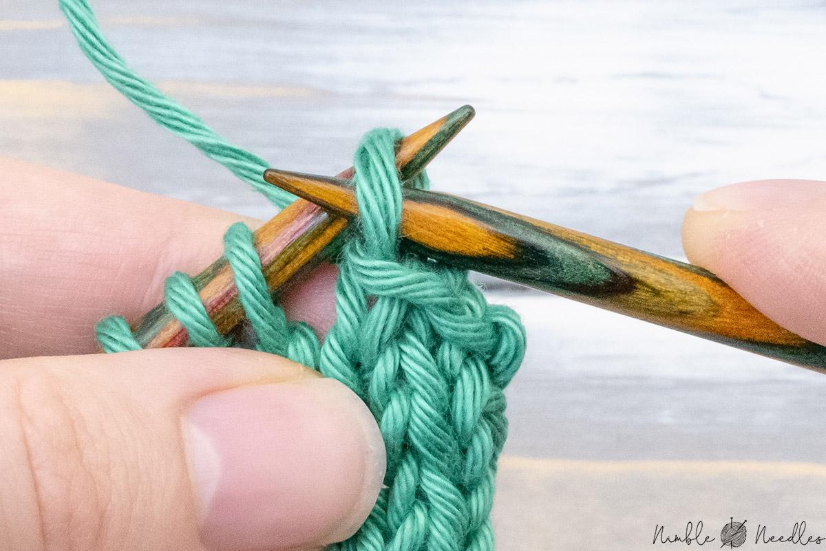 slipping the remaining stitch back to the left needle