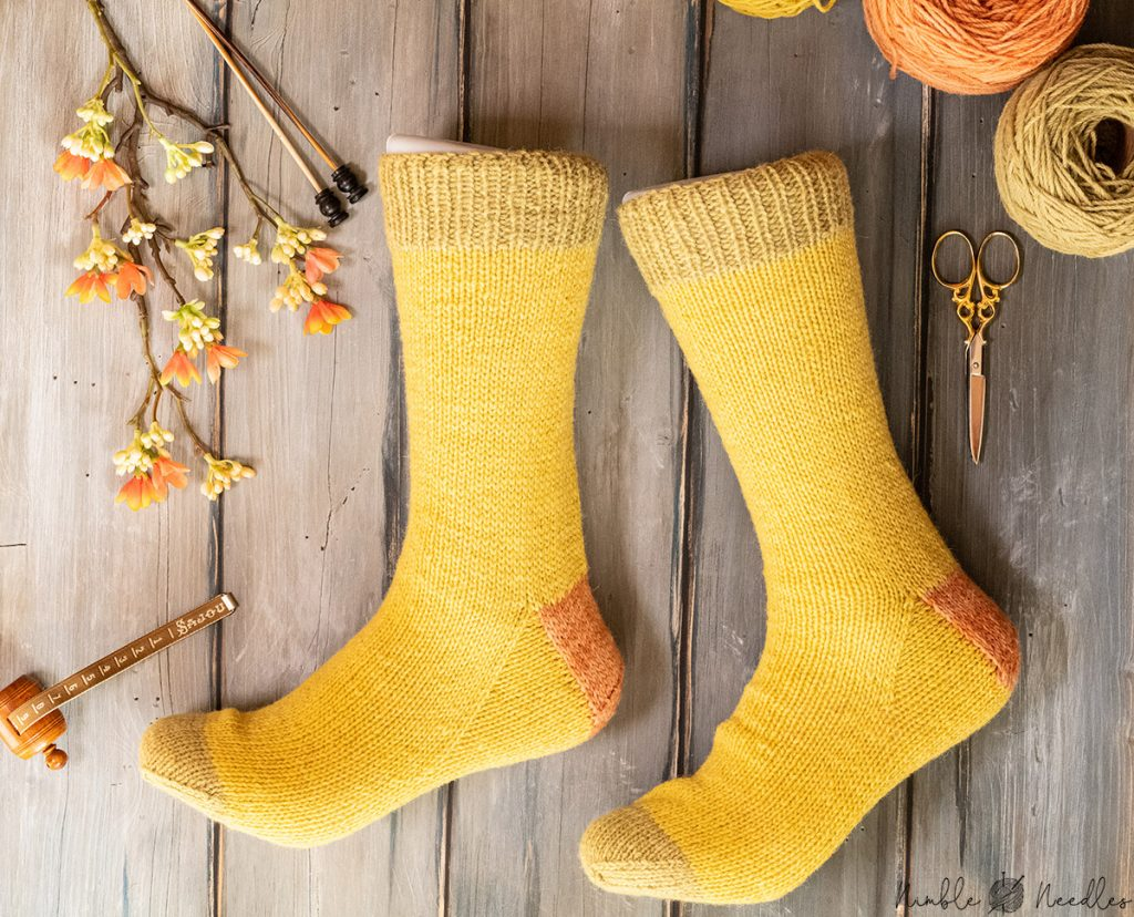 the finished plastic-free socks modeled on feet so you can see them in full glory